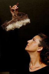 Nicole Foreshew studies gypsum crystals growing on vegetation in the Australian Museum.