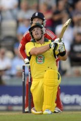 Aaron Finch hits a six watched by England's Jos Buttler.