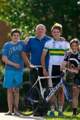Jack Cummings, a young cyclist who has just been signed by a German team, with his father Mick, brother Tom (left) and sister Georgia.