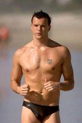 Scott Miller jogging along a Gold Coast beach in 2002.