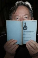 Simon Maddox with one of the 21 military doctrine training pamphlets that were seized by military police.