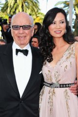 Media magnate Rupert Murdoch with former wife Wendi Deng. Prime ministerial aspirant Clive Palmer is furious about a story in Murdoch's Australian newspaper about the mining billionaire.