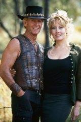 In the beginning: Paul Hogan and Linda Kozlowski on the set of <i>Crocodile Dundee</i>.