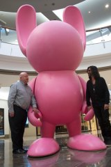 """Brisbane Festival artistic director Noel Staunton and artist Stormie Mills welcome the first of a number of """"bunnies"""", sculptures that will be popping up around town during this year's event."""
