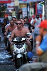 Traffic hazard ... tourists in Bali.