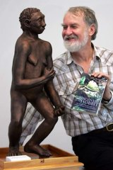 Sapiens meets Floresiensis: Mike Morwood with a model of his tiny find.