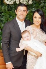 Pure joy: Terry Biviano, Anthony Minichiello and baby Azura on her christening day.