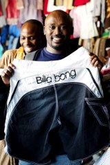 Counting quality ... Polly Kaliisa with a pair of men's Billabong board shorts at Owino market.
