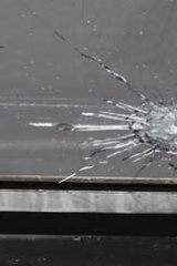 Ricochet: A shot fired at the van also hit the centre.
