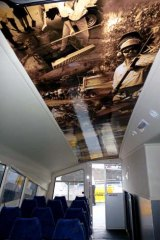 """A photo montage inside """"The Spirit Of Brisbane"""" shows workers cleaning up after the January floods."""