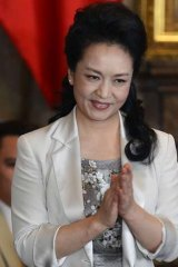 Turning on the charm: Chinese First Lady Peng Liyuan.