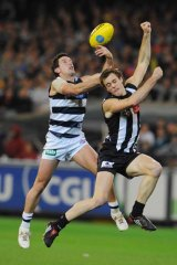 Preliminary Final, 2009. Geelong forward Shannon Byrnes competes with Collingwood defender Alan Toovey.