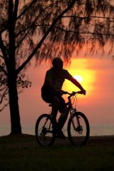 Mode share ... a cyclist at sunset.