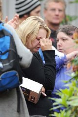 Hoping against hope ... a woman weeps as family and friends of the coalminers who are trapped underground  leave a briefing from the management of Pike River Coal in Greymouth.