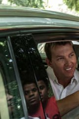 Embracing the culture … Brett Lee takes to the streets in India.