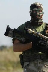 A pro-Russia separatist sniper on the outskirts of Shakhtersk on Thursday.