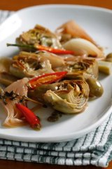 Braised artichokes with onions, olives and capers.