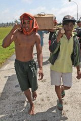 Residents carry a coffin on November 10, 2013 in Santa Fe, Leyte, Philippines.