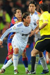 The referee shows a red card to Real Madrid's defender Sergio Ramos.