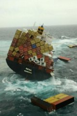 Containers float near the grounded container ship 'Rena' in the Bay of Plenty near Tauranga, New Zealand.