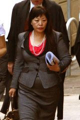 Helen Liu enters the court yesterday.