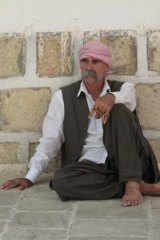 A Yazidi man in the courtyard of Sheikh Adi's shrine, where all must walk with bare feet.