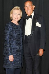 Hillary Clinton wearing an Oscar de la Renta pant suit with the designer himself at the 2013 Council of Fashion Designers of America awards.