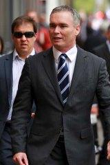 Card use: Craig Thomson at court.