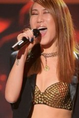 Elly Oh-M-G in a gold top.