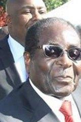 Psychology Maziwisa with  Zimbabwean President Robert Mugabe.
