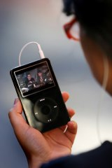 A viewer watches video on an iPod.