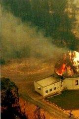 Mount Stromlo Observatory burns during Canberra's 2003 bushfires.