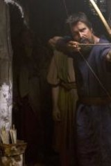 Straight and true: Moses (Christian Bale) takes aim, as Nun (Ben Kingsley) looks on.