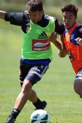 Tussle … Alessandro Del Piero battles with Hagi Gligor as Sydney FC train for Sunday's game against Perth Glory.