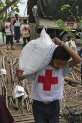 Myanmar Red Cross workers unload emergency food donations.