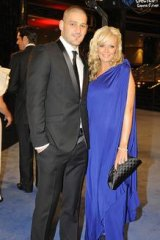 Before the booze-up ... Brendan Fevola and wife Alex at the classier end of the evening.