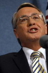 Threatens to withhold GST revenue from states ... Treasurer Wayne Swan.