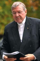 Apologetic: Cardinal George Pell arrives at the inquiry.
