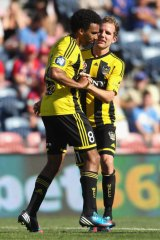 Goalscorers Paul Ifill and Jeremy Brockie of the Phoenix celebrate. Brockie scored either side of half-time.