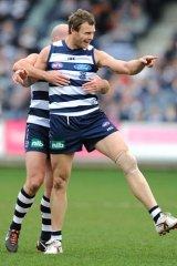 Cameron Mooney celebrates one of his five goals during Geelong's rout of Melbourne.