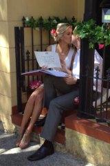 Bride and groom Lorraine Murphy and Wade Tink kiss at their doorstep wedding 'elopement' in Bondi.