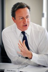 The British Prime Minister, David Cameron, is under pressure to call a judge-led inquiry into the phone-hacking scandal.