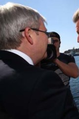 On the trail: Rudd is confronted by Barry O'Farrell.
