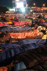 94b1bc7100 Thousands sleep outside before a ceremony marking the 98th anniversary of  Anzac Day at Anzac Cove