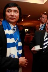 Mitchell with Li Cunxin and Robert Doyle at the North Melbourne grand final breakfast at Etihad Stadium.