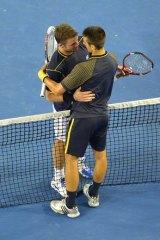 Djokovic consoles Wawrinka after the game.