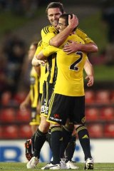 On the rise: Manny Muscat and Tim Brown celebrate a Phoenix win.