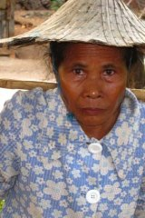 Jublina Ndollu, John Ndollu's mother, walks 10 kilometres a day to work in rice fields.