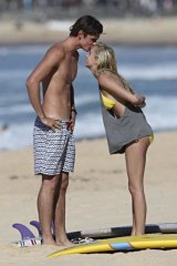 Close-up: The Voice's Laura-Leigh Smith and boyfriend surfer Jack Entwistle at Manly Beach.
