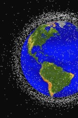 This computer generated graphic provided by NASA shows images of objects in Earth orbit that are currently being tracked.  Space junk has made such a mess of Earth's orbit that experts say we may need to finally think about cleaning it up.